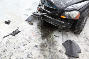 Broken car on road in winter; crash accident